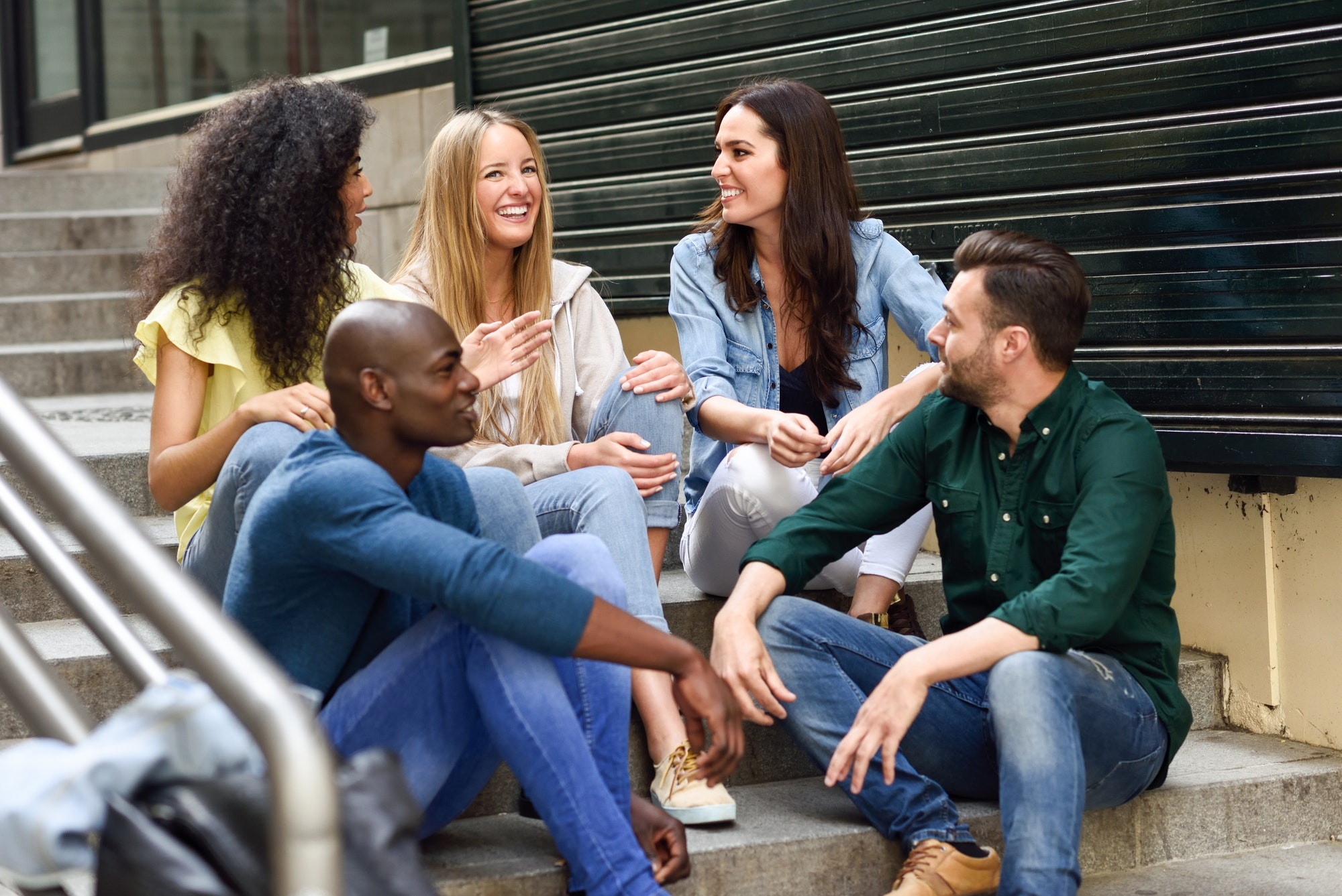 message testing: Group of friends having fun together outdoors
