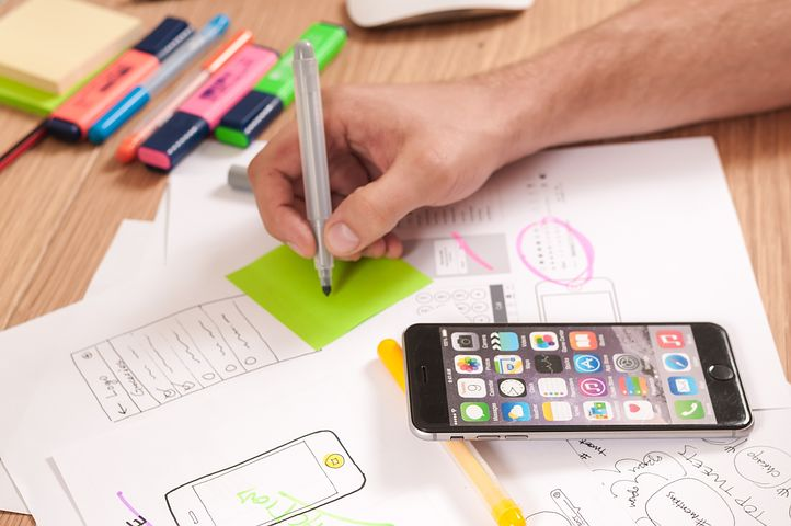 Mockup testing: a messy desk with design ideas
