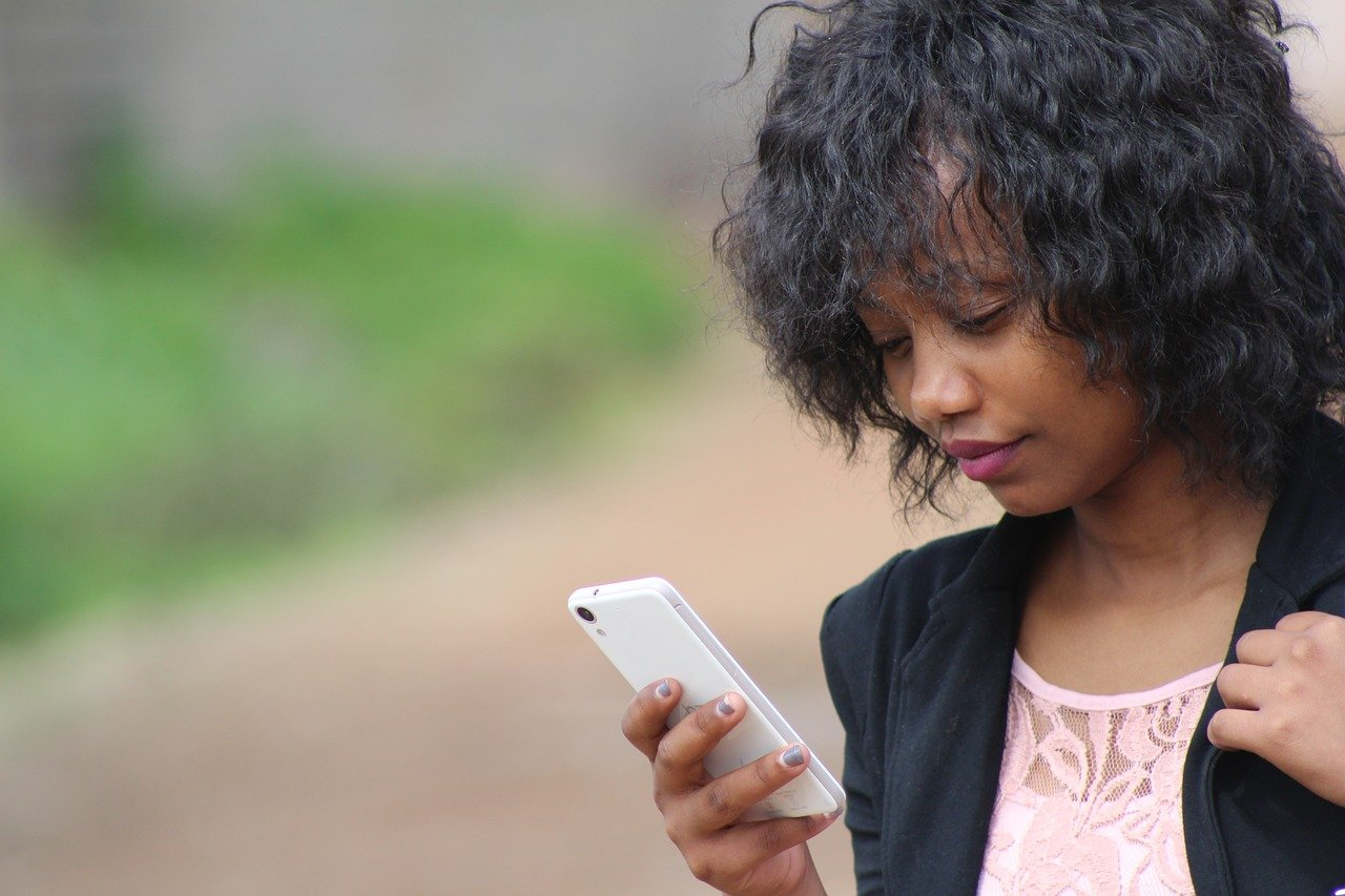 Mobile app optimization: Woman scrolling on her phone
