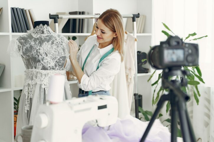 Clothing designer takes photographs of designs for e-commerce