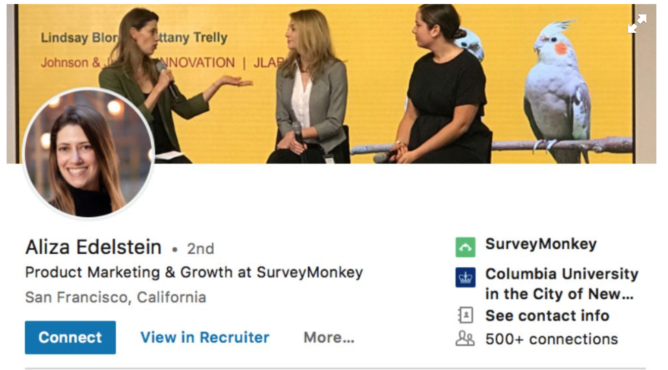 An example of a woman's LinkedIn profile with a cover photo showing her talking with other women