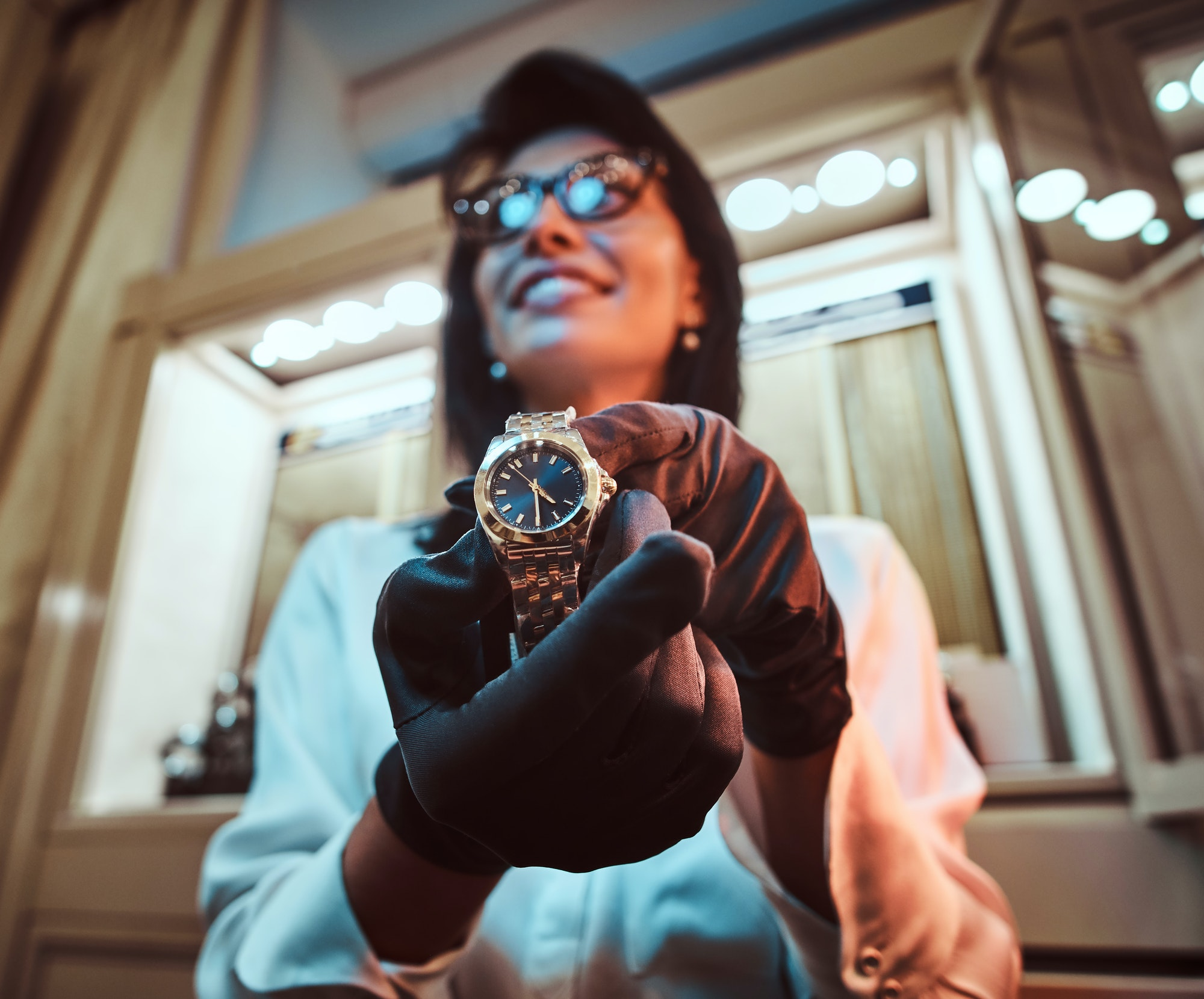 Message testing: Seller shows an exclusive men's wristwatch from the new collection in the luxury jewelry store