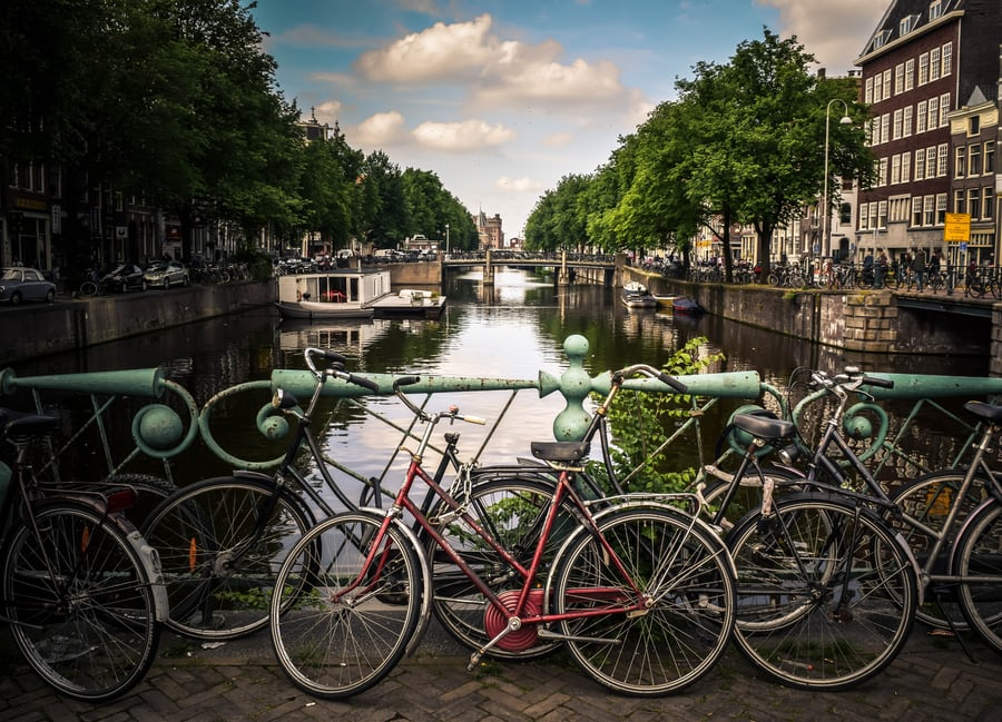 An image of bicycles and a canal in Amsterdam.