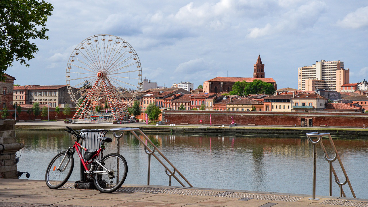 Image showing a canal and ferris wheel in Toulouse, France.