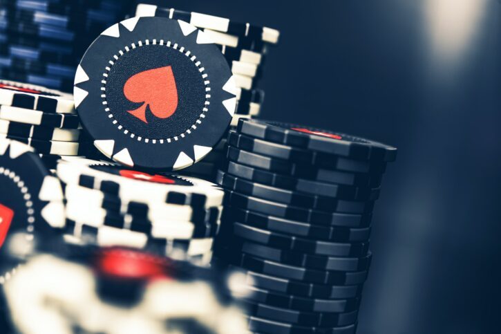 Poker Chips Stacked On Casino Table.
