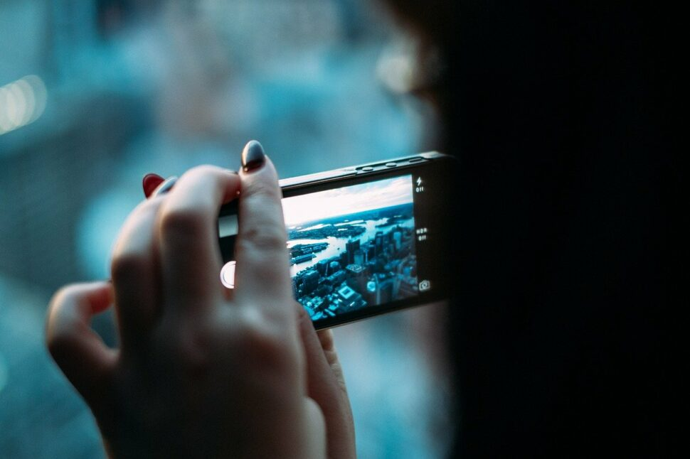 An image showing a hand holding a phone with a blue screen.