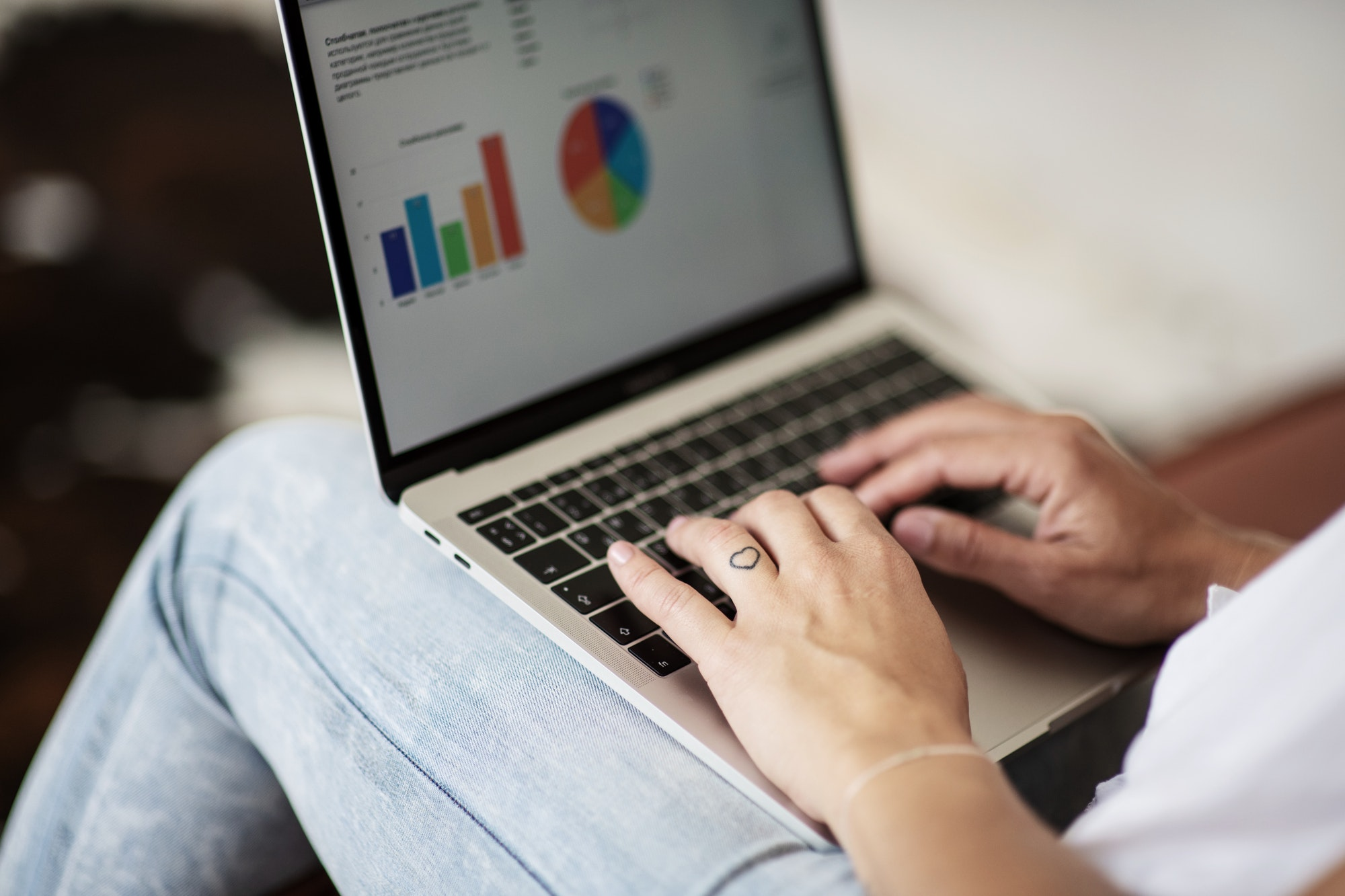 Woman using laptop to see metrics for e-commerce business