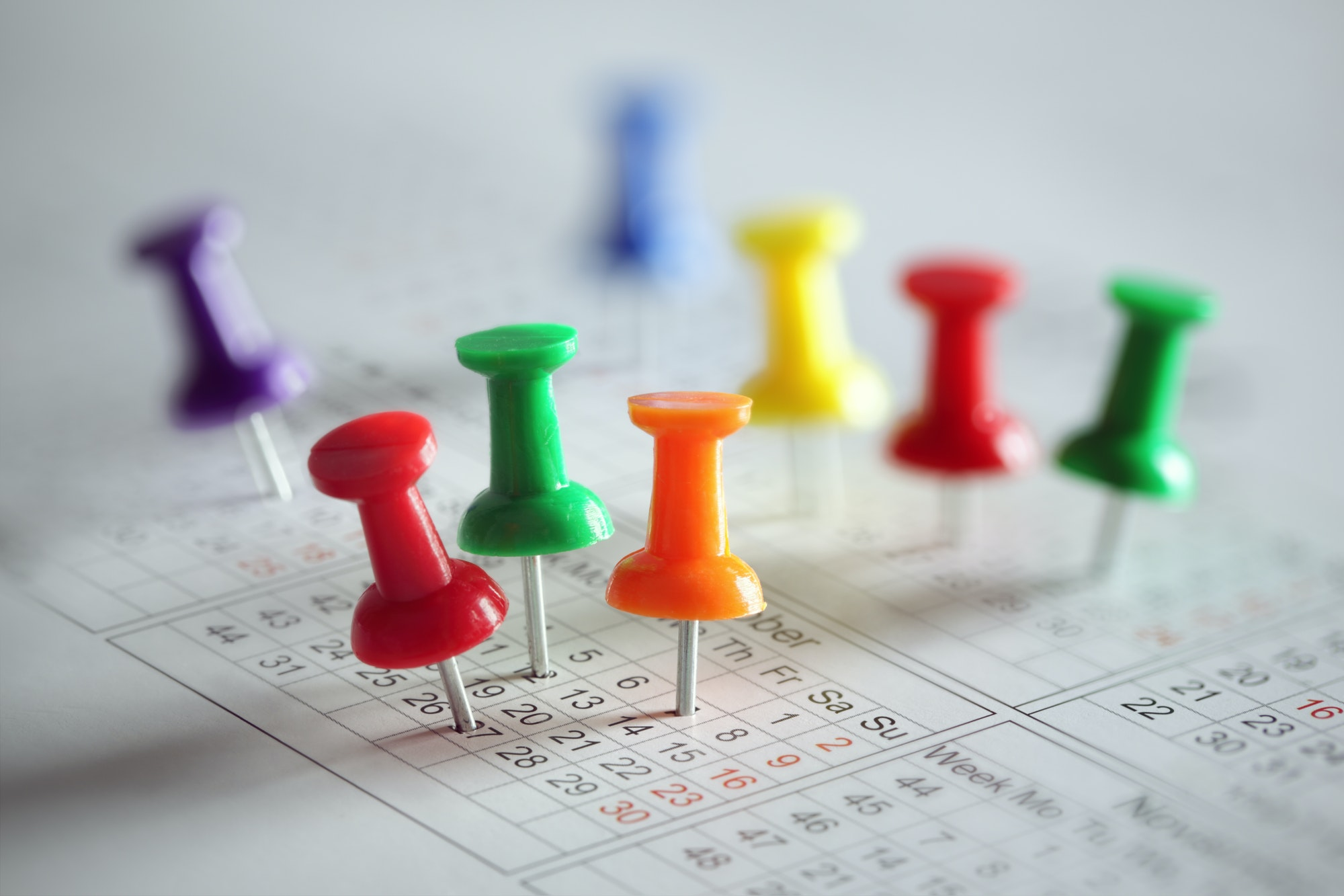 Image of push pins in a calendar