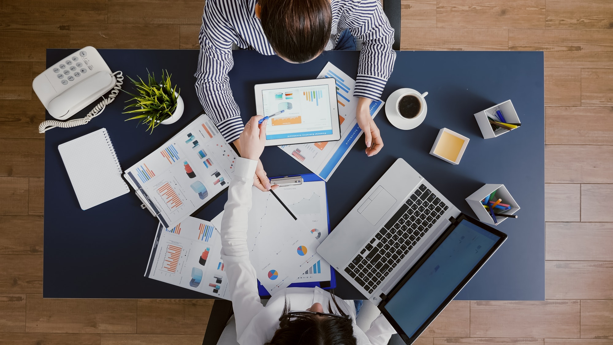 E-commerce business valuation: Top view of managers looking at accounting paperwork